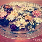 vintage brooches on cake plate