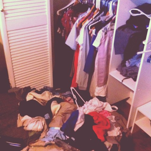 clothes exploding out of closet