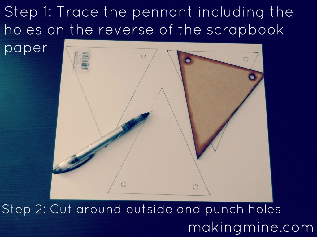 trace the pennant including the drill holes on the reverse of the scrapbook paper