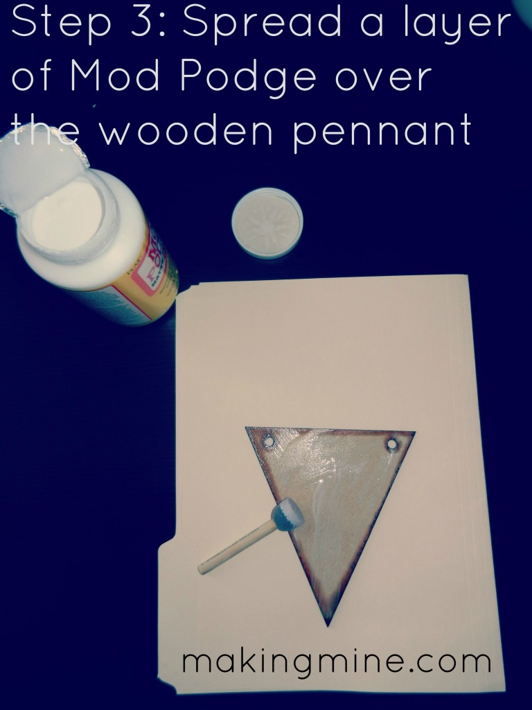 sponge mod podge on the wooden pennant