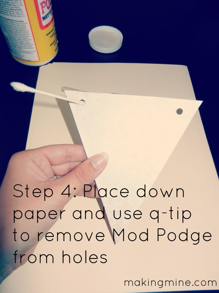 Place down paper and use q-tip to remove glue from holes