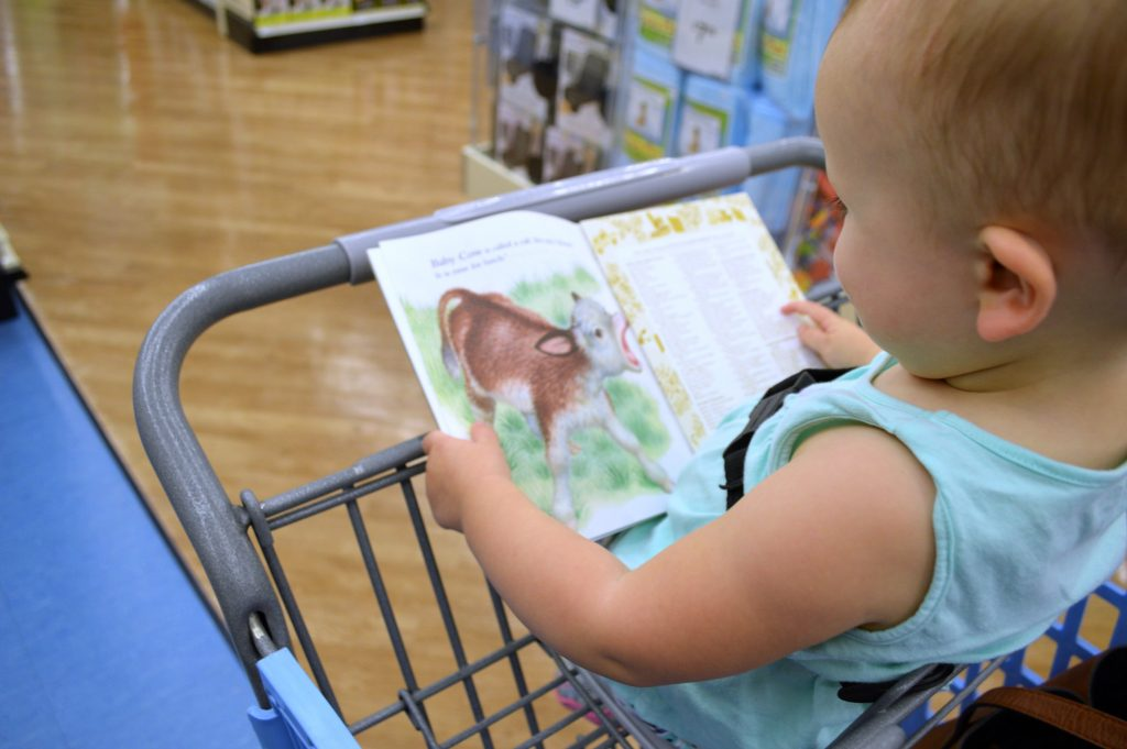 picking out books at buybuy BABY