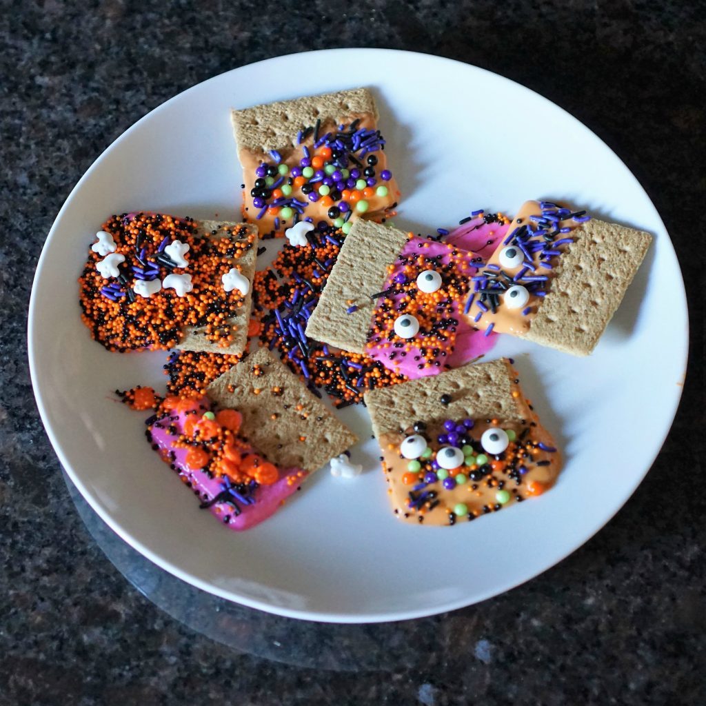 Spooky Silly Snack for Preschoolers: Yogurt Dipped Graham Cracker Monsters