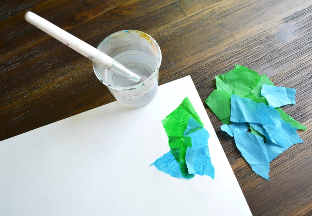 Tissue paper bleeding to make a world for this easy, fun Father's Day craft!